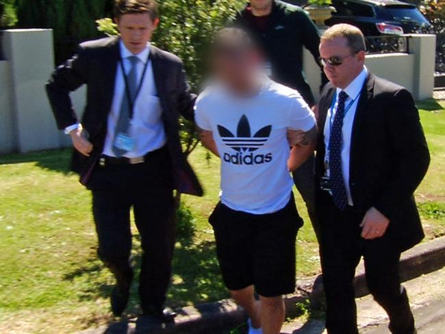 Homicide Squad officers arrest a man over the murders.