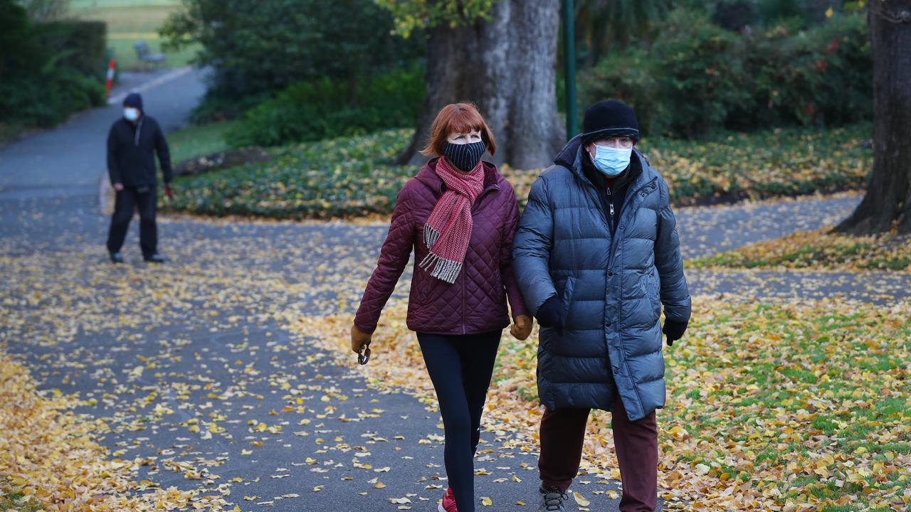 People get their exercise on a cold Melbourne morning during COVID lockdown. Picture: David Crosling