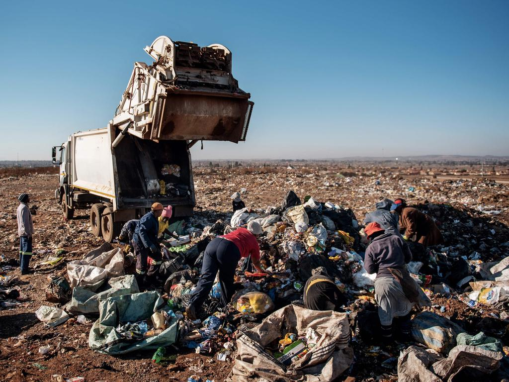 Reclaimers collect waste at the Palm Springs landfill on the outskirts of Johannesburg, South Africa. A report commissioned by the Department of Environmental Affairs estimated that there are 62,147 informal recyclers in the country. Picture: Michele Spatari/AFP