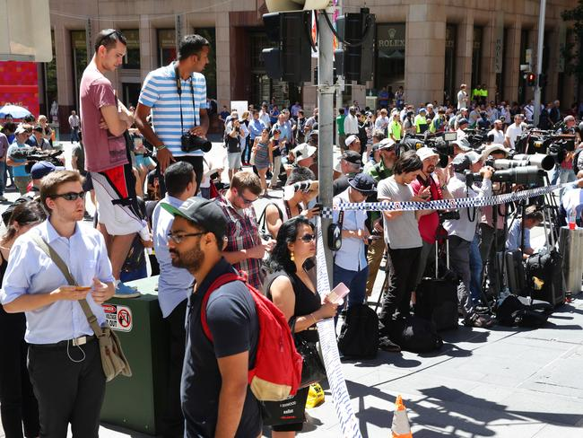 Media with an onlookers ... in Martin Place at the scene of the siege at the Lindt cafe. Picture: Cameron Richardson.