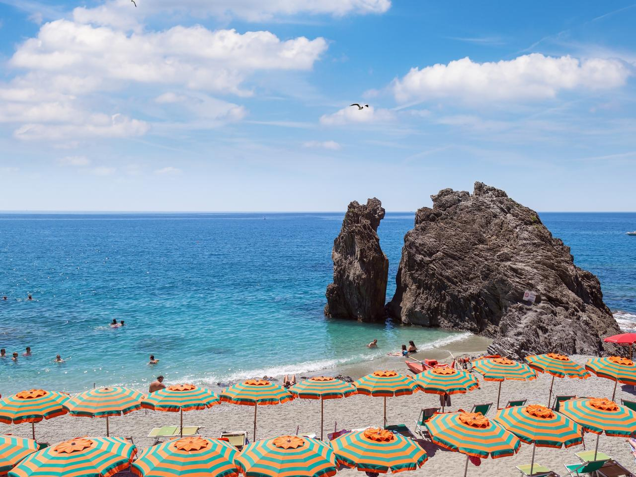 Beautiful view of beach in village of Monterosso. Sundy beach with cloud sky.