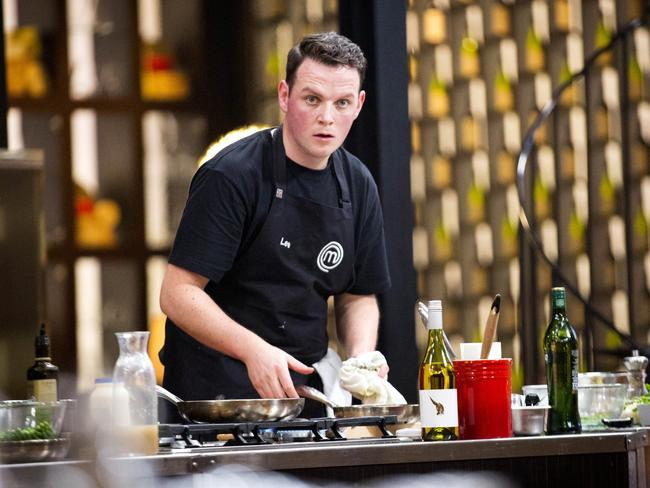 MasterChef contestant Lee Behan feels the pressure as he tries to follow Gary Mehigan's cooking. Picture: Channel 10