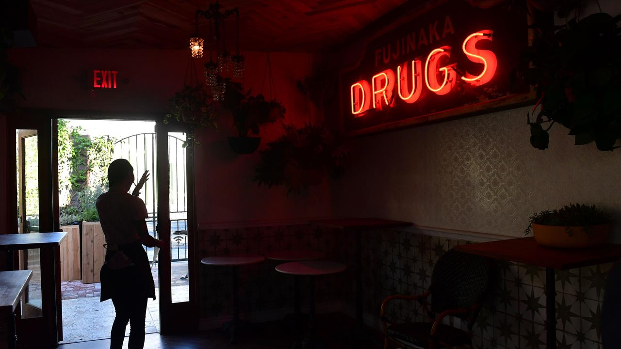 A waitress is silhouetted through a doorway at the Cannabis Cafe in West Hollywood, California, a day before its official opening. Picture: Getty
