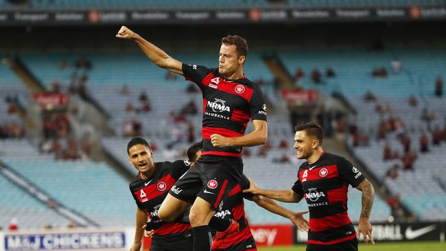 Oriol Riera (top) of the Wanderers celebrates