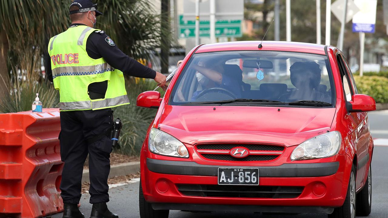 Police work at a checkpoint at the Queensland and NSW border. Picture: NCA NewsWire / Jono Searle