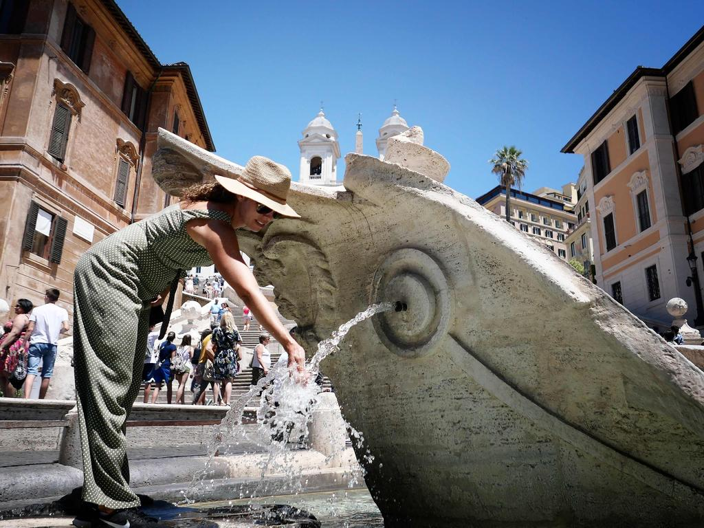 A woman refreshes at the Fontana della Barcaccia on Piazzia di Spagna in downtown Rome. Picture: AFP