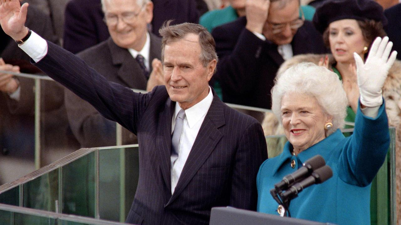 January 1989: US President George H.W. Bush and first lady Barbara Bush, wave to the crowd at the US Capitol after being sworn in as 41st president of the United States. Picture: AP