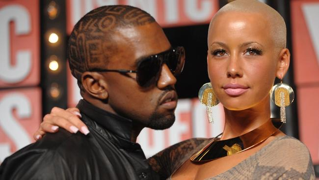 Messy breakup ... Amber Rose and Kanye West, pictured together in 2009, are trading insults. Picture: AP Photo/Peter Kramer