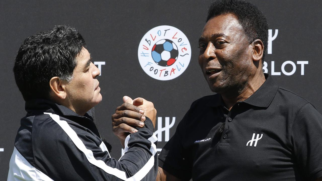 Maradona and Pele are two footballing greats but what legacy will their friendship leave? / AFP PHOTO / PATRICK KOVARIK