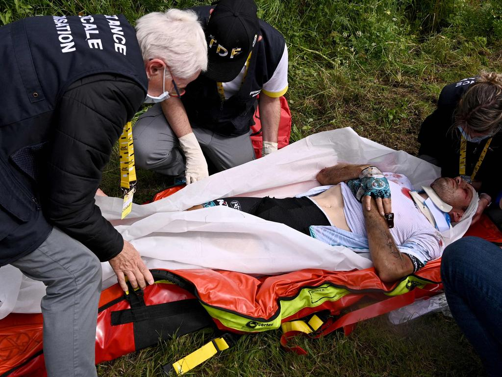 Medics rushed into action. (Photo by Anne-Christine POUJOULAT / various sources / AFP).