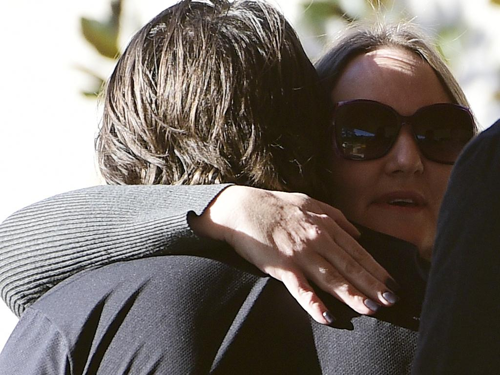 Heidi Brosnan (right), mother of Callum Brosnan who died at Knockout Games of Destiny music festival in December 2018, embraces a friend of her son upon arrival at the Coroner's Court of New South Wales in Lidcombe, Sydney. Picture: AAP