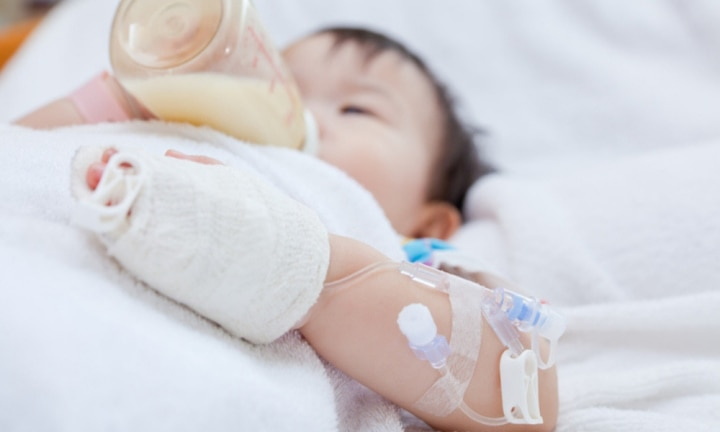 toddler in hospital bed