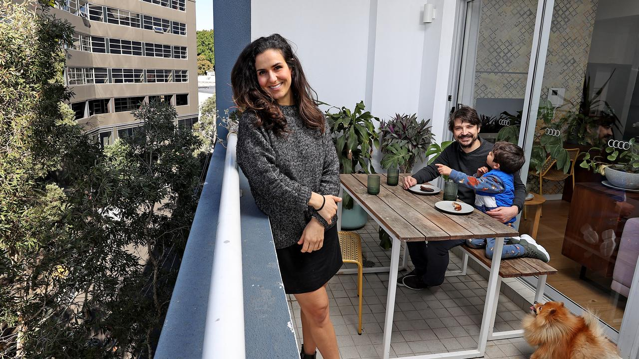 Stefania and James Reynolds with their son, Theo, 3 at their Surry Hills apartment they have just sold. Picture: Toby Zerna