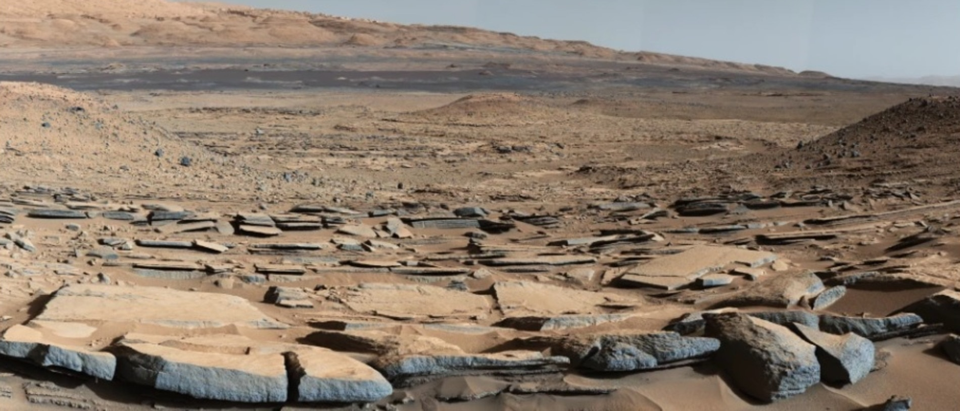 This is the Kimberley formation, snapped by Nasa's Curiosity rover. The way the land dips towards Mount Sharp suggests that water flowed towards a basin that once existed. Picture: NASA