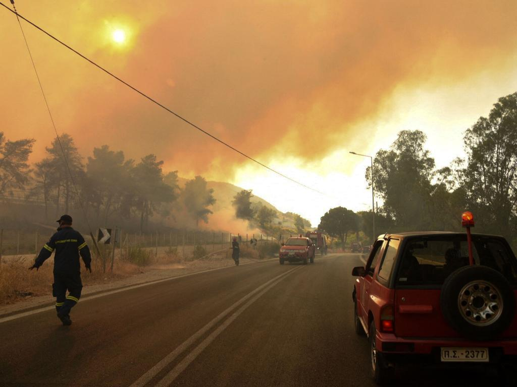Greek authorities grappling with a large forest fire. Picture: STR/Eurokinissi/AFP