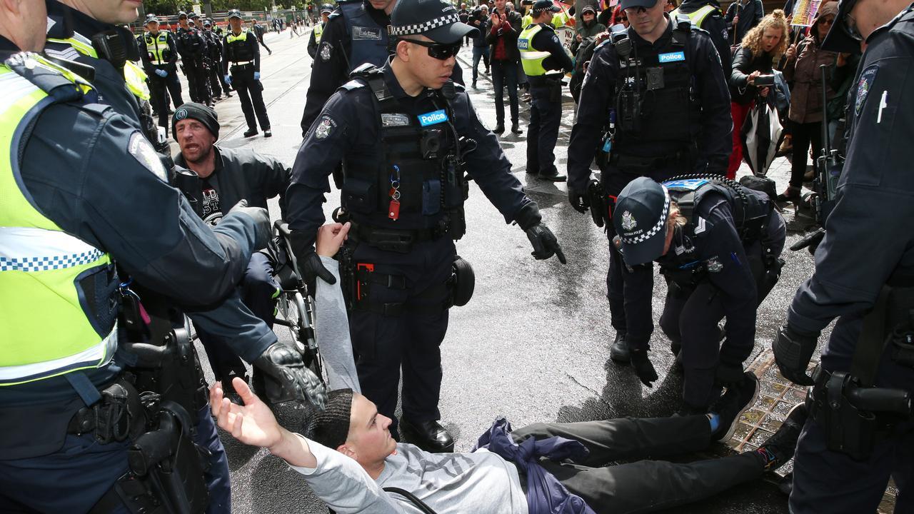 Police cart off Exctinction Rebellion protesters in Melbourne's CBD. Picture: David Crosling