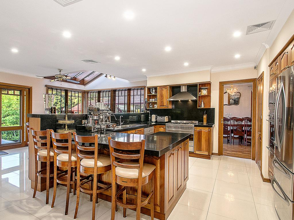 The kitchen has easy access to the outdoor dining area