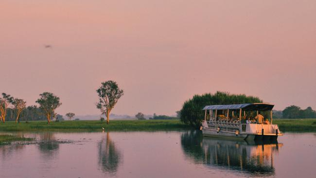 Yellow Water Cruise's vessel on the billabong at sunrise.