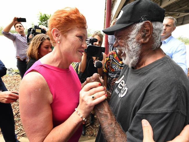 One Nation leader Pauline Hanson meets Aboriginal man Walter Reid under the Fitzroy Bridge in Rockhampton. Picture: AAP/Dave Hunt