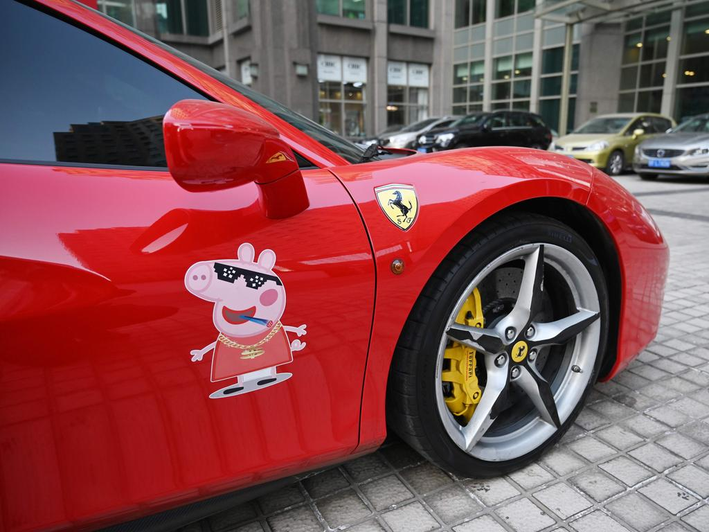 This picture taken on February 1, 2019 shows a Peppa Pig figure seen on the side of a Ferrari 488 parked outside an office building in Beijing. Picture: AFP