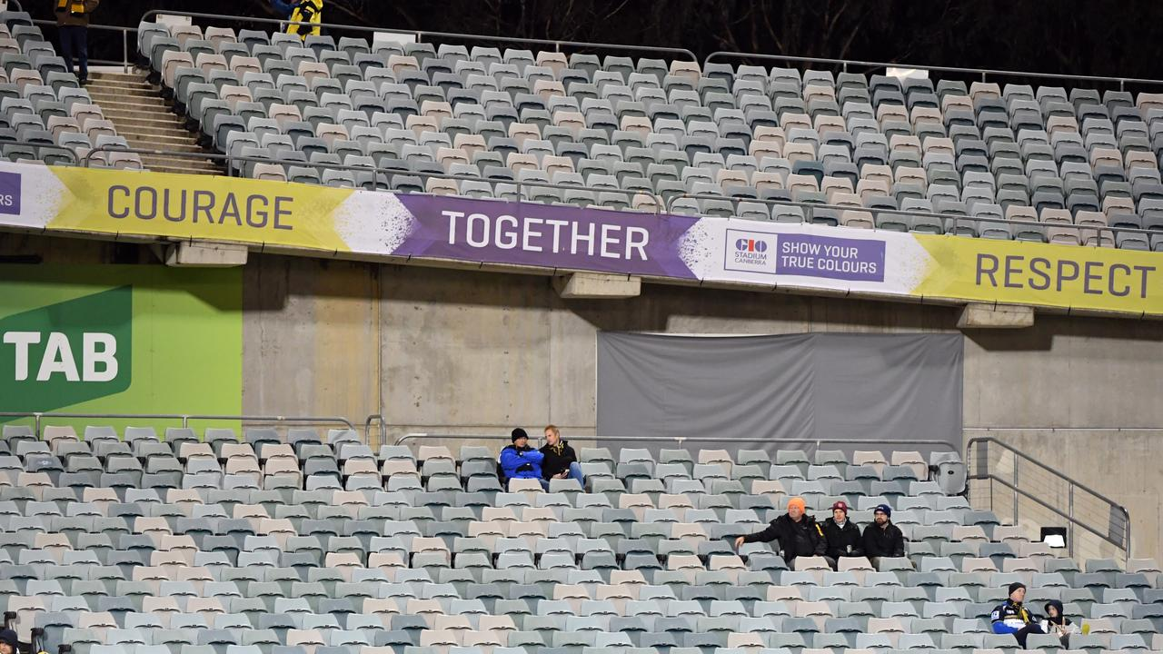 A near empty stand at a Super Rugby game.