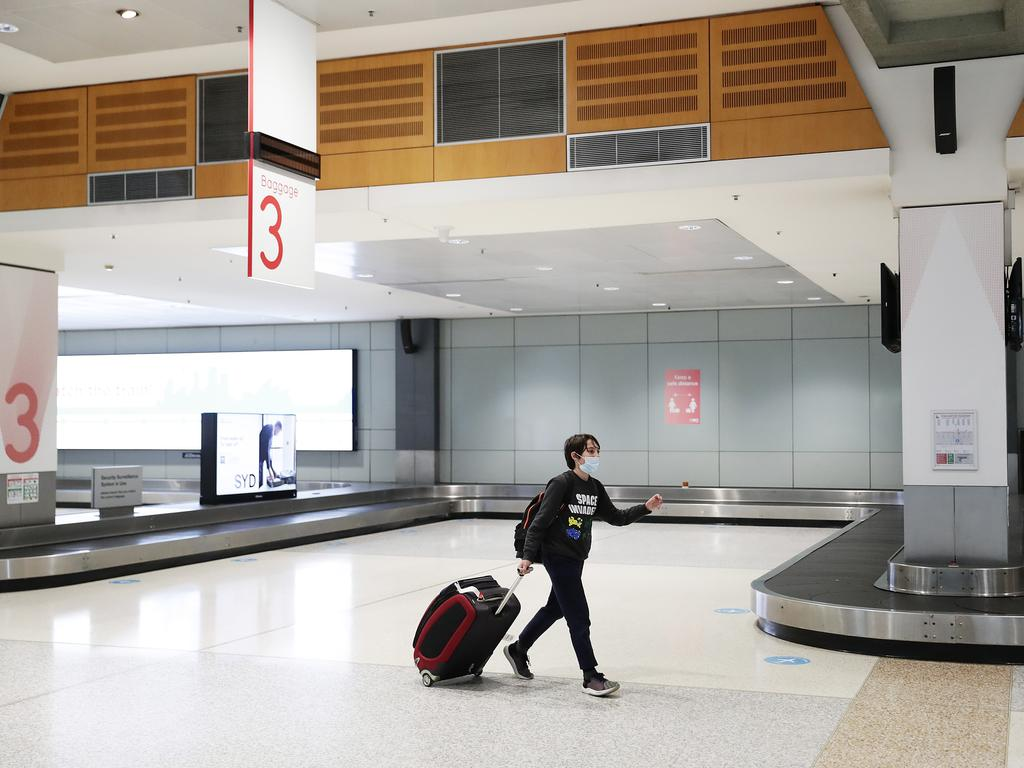 A passenger at Sydney Airport after arriving from Melbourne. Picture: Mark Metcalfe/Getty Images