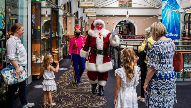 A man dressed as Santa Claus waves to people in Sydney's Queen Victoria Building on December 21, 2020 in Sydney. Picture: Getty Images