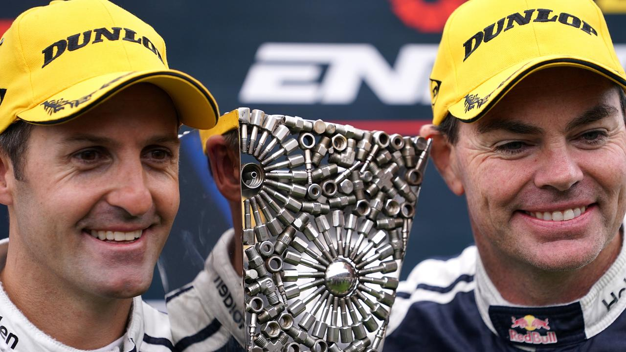 Jamie Whincup (L) and Craig Lowndes celebrate after claiming the Sandown 500.