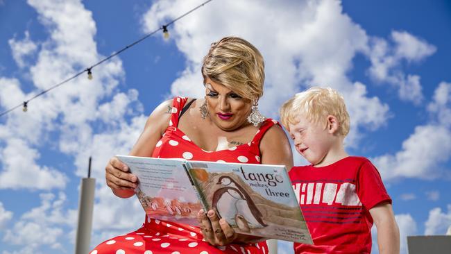 Gold Coast drag queen Dame Martini Fernando Ice reading to Cody Jasinski, 5.  Picture: Jerad Williams