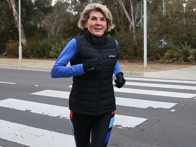 Ms Bishop happily jogs into Parliament House this morning. Picture: Kym Smith