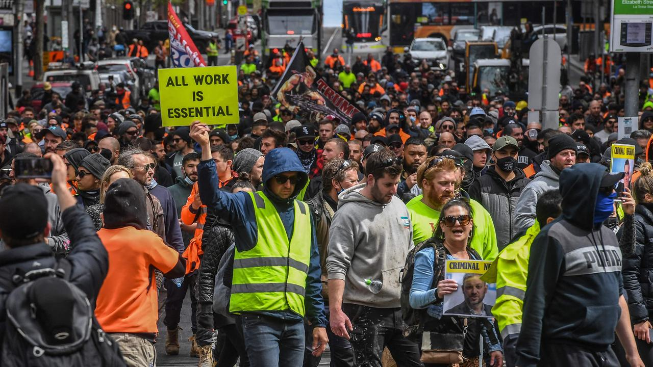 Construction workers and demonstrators attend a protest against Covid-19 regulations in Melbourne on September 21. Picture: William West/AFP