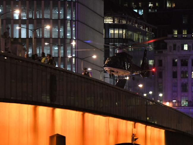 An emergency response helicopter lands on London Bridge. Picture: AFP