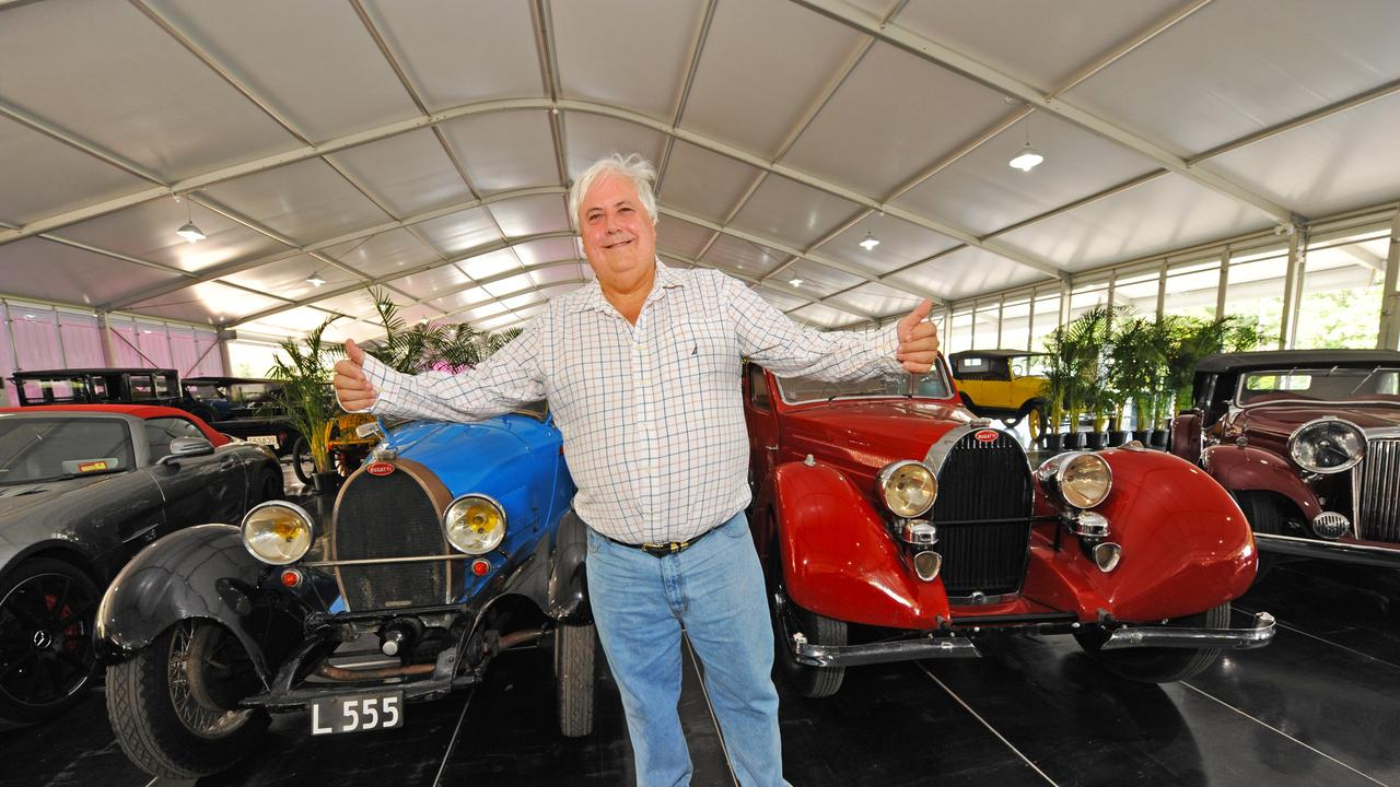 Clive Palmer in front of his brace of Bugattis at the Palmer Motorama at Palmer Coolum Resort. Photo: Iain Curry