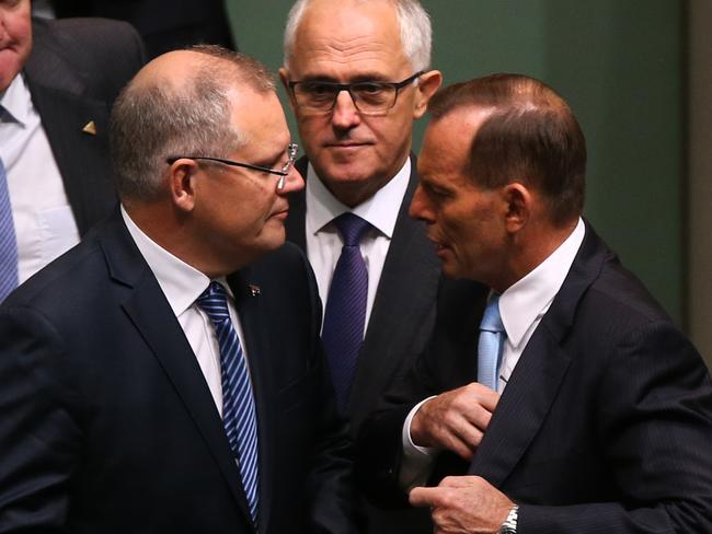 Holding on as leader ... Scott Morrison, Malcolm Turnbull and Tony Abbott in the House of Representatives after a condolence motion on the Sydney siege. Picture: Kym Smith