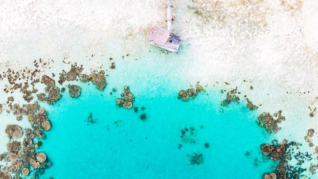 Aerial view of jetty and reef Haggerstone Island  credit Mark Fitz  escape  october 25 2020  wishlist