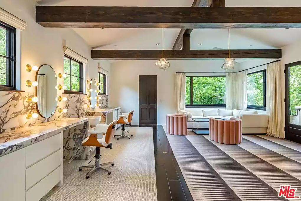 The vanity area is in a room with peaked, beamed ceilings. Picture: Realtor