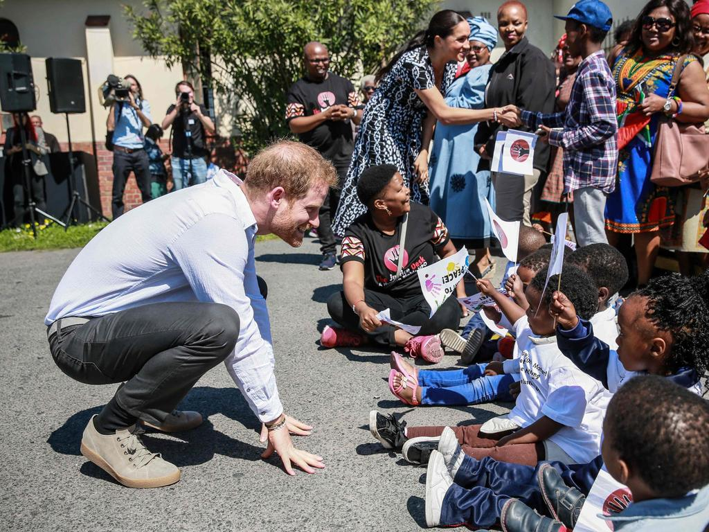 Harry is always a hit with the children. Picture: Betram Malgas/AFP