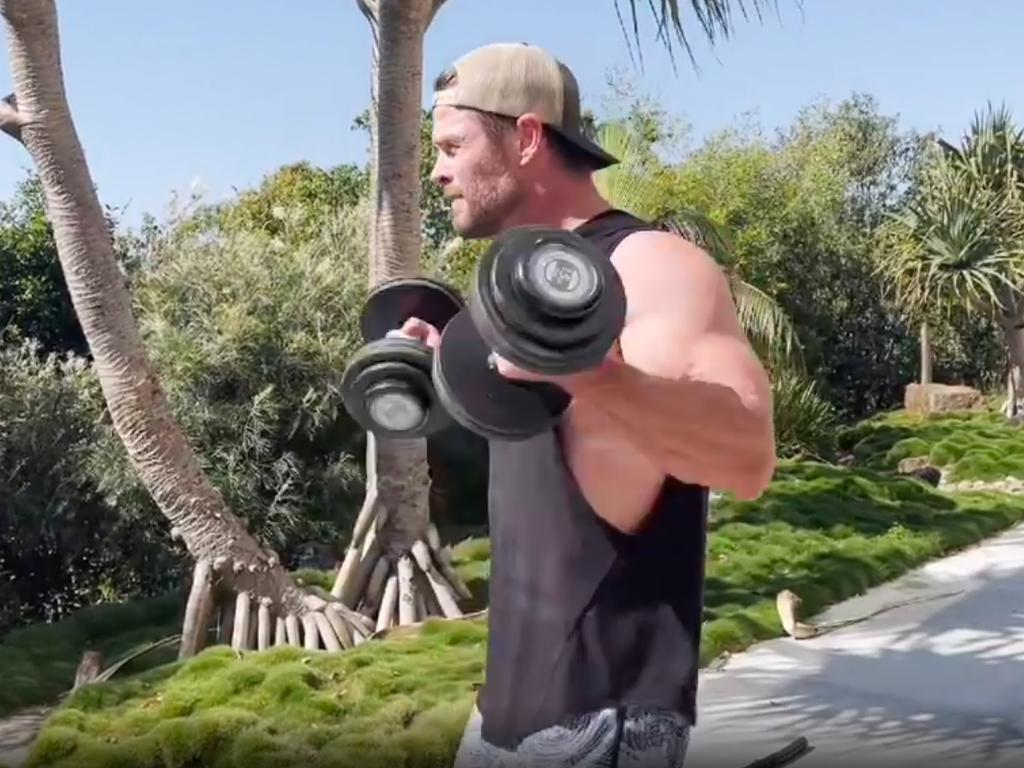 He showed off his bulging biceps as he did bicep curls. Picture: Instagram/ChrisHemsworth