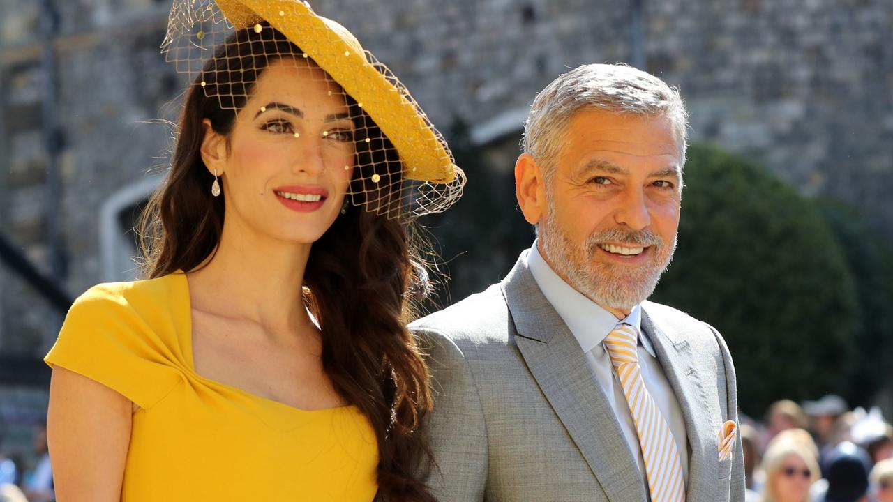Amal and George Clooney looking chic as they arrive for the royal wedding. Picture: Gareth Fuller/AFP