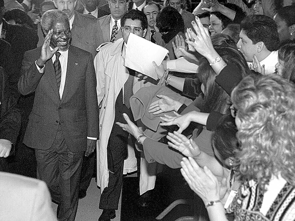 Former UN Secretary General Kofi Annan being greeted by United Nations staff in lobby of the Secretariat building in New York after his Iraq deal averted threat of war. Picture: AP