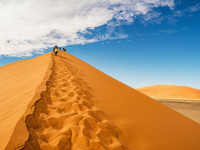 1. SOSSUSVLEI, NAMIBIA With some of the cheapest national parks in Africa, Namibia provides spectacular scenery at a low price. Must-sees include the spectacular Sossusvlei, an arid salt pan surrounded by high red dunes, and the Ethosha National Park, where tourists can experience a self-drive safari. There's also Fish River Canyon, which is comparable to the Grand Canyon. The trick to having a super-cheap holiday in Namibia is to centre your holiday around nature, and to take advantage of their camping grounds which can cost as little as A$10 a night.