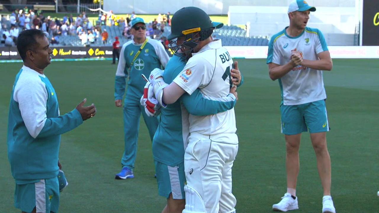 Justin Langer congratulates Joe Burns after his half century guided Australia home.
