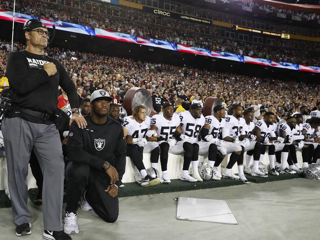 Some members of the Oakland Raiders sit during the playing of the National Anthem before an NFL football game against the Washington Redskins. Picture: AP Photo/Alex Brandon