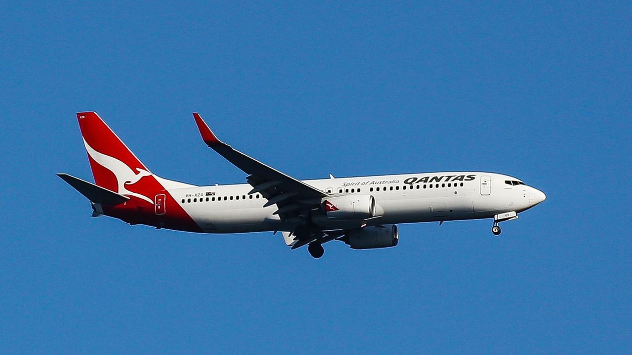 SYDNEY, AUSTRALIA - NewsWire Photos, SEPTEMBER, 12 2021: Qantas fly's over Bronte Beach in Sydney: NCA NewsWire / Gaye Gerard