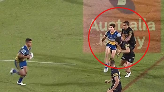 Mitch Moses is held back by Jarome Luai.