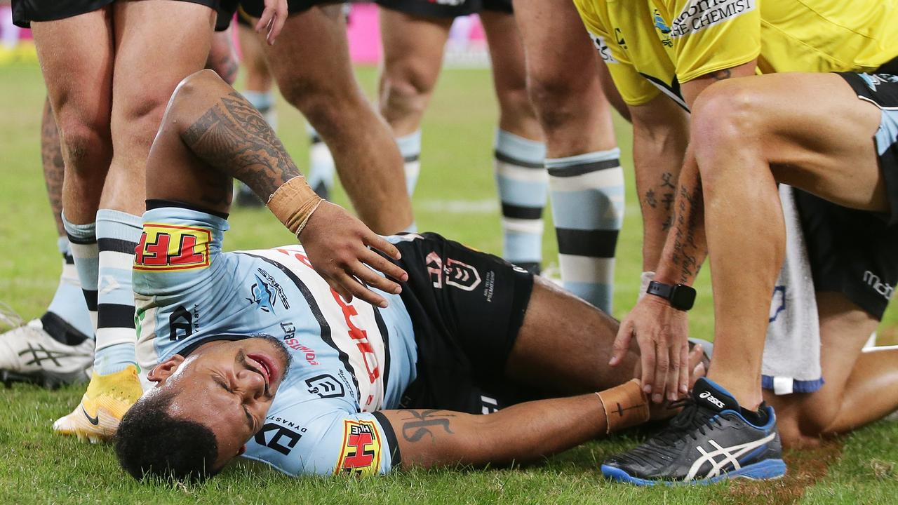 Sione Katoa of the Sharks is assisted after sustaining a knee injury (Photo by Matt King/Getty Images)