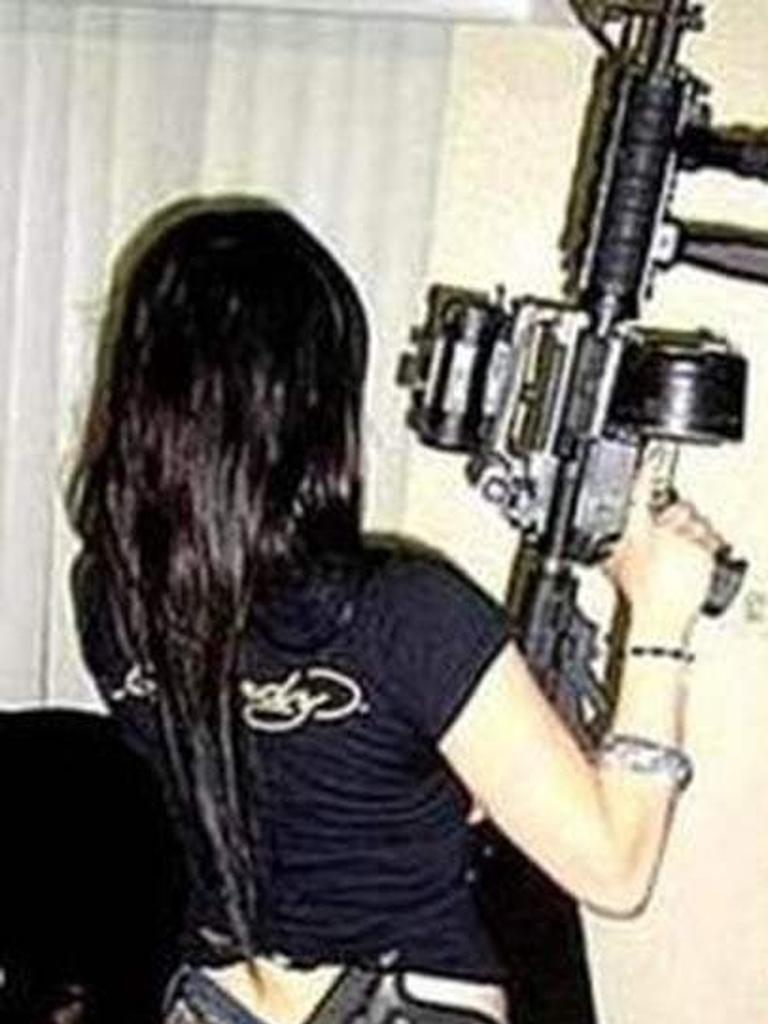 Snaps from her social media showed her posing with guns.