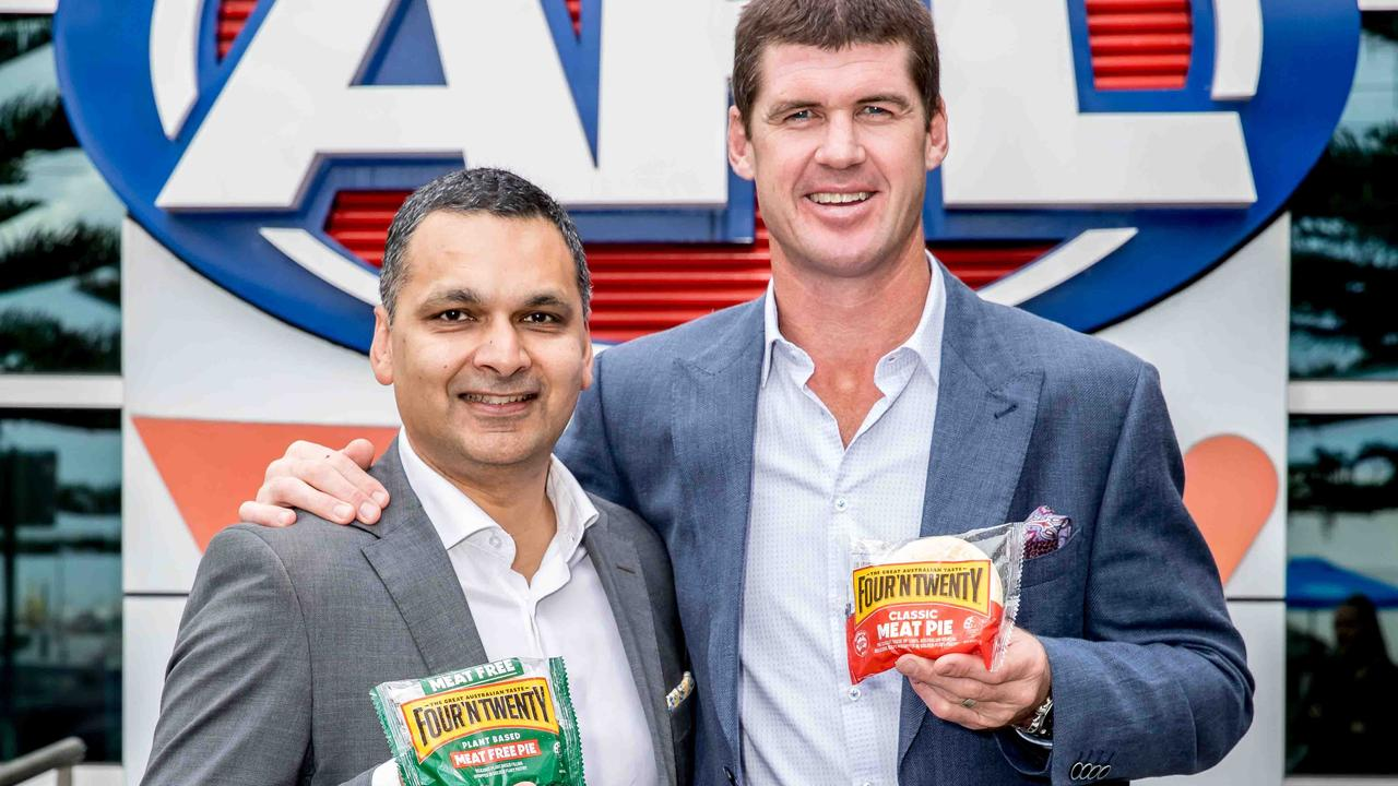 General manager of marketing and innovation Anand Surujpal with former AFL footballer and Four'N Twenty ambassador Jonathan Brown. One-in-three spectators at MCG sporting matches eat a pie, according to Patties Foods.