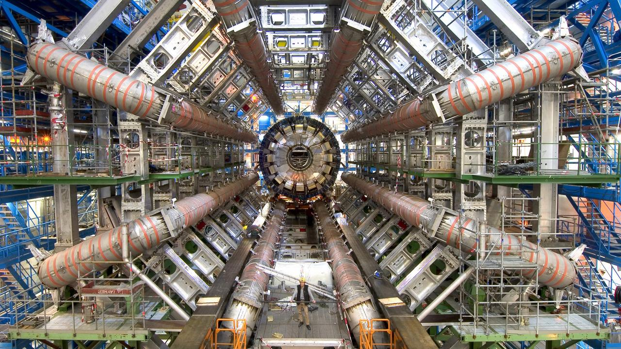 Worlds largest particle accelerator to carry out experiments colliding protons to discover new forms of matter being built in Geneva, Switzerland by the European Nuclear Research Centre (CERN). science physics