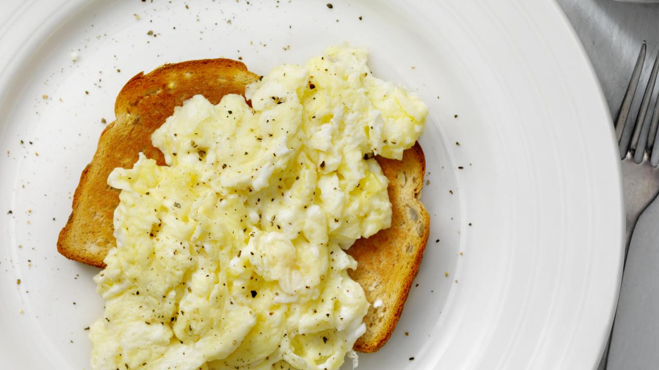 Perfect, light, fluffy and buttery scrambled eggs on toast.